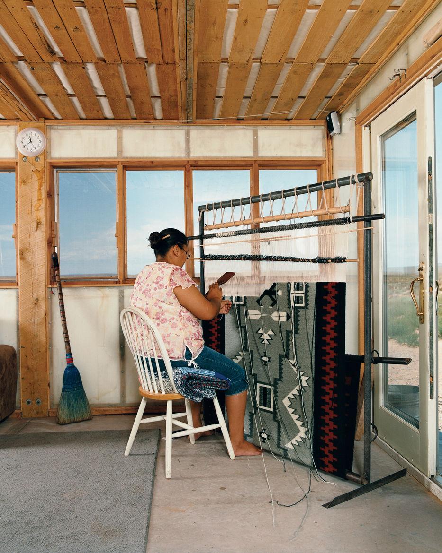 Rosie Joe weaves a traditional Navajo rug.