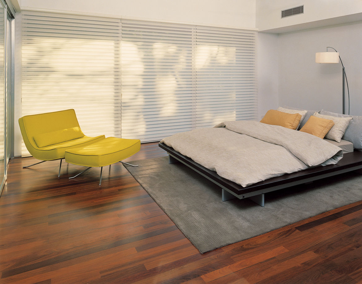 Blinds in the master bedroom provide privacy from the street.