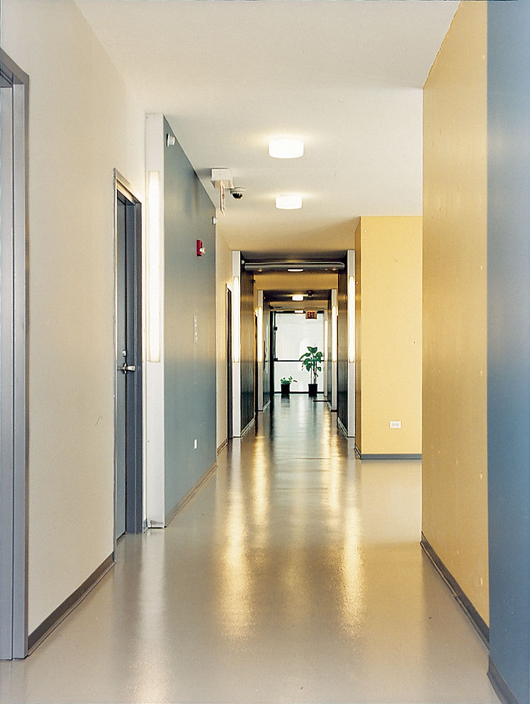 The spacious corridors of the Schiff Residences are clean, well-maintained, and warmly colored—-a convincing hybrid of social housing and home.