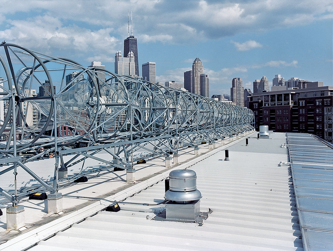 A horizon-line of rooftop wind turbines turns the skies of the Windy City into an omnipresent source of electrical power. Installed by the Chicago-based firm Aerotecture International, the turbines give the building both a steady supply of power and a dis