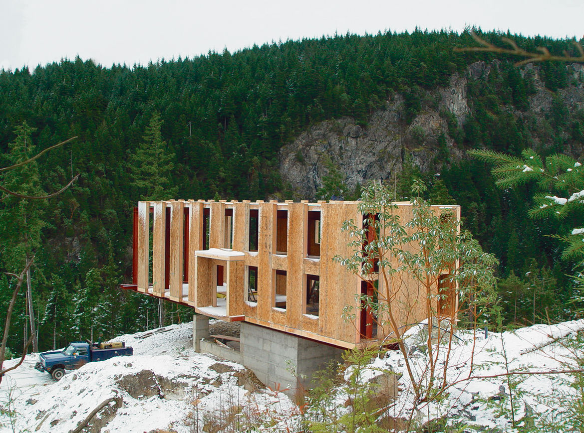 "The use of structural insulated panels (SIPs) throughout the house helped speed the construction process. Peter Anderson explains, ""The panels themselves hang from and rest upon the steel frame and wood spline beam system, which is the link between the st"