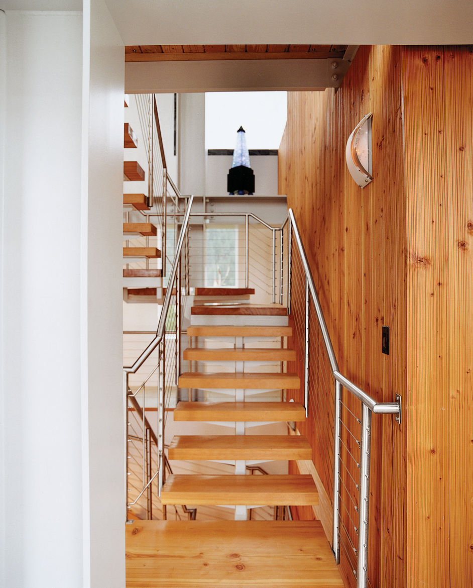 The stairs and the wood paneling were designed and built by wood-worker Noah Israel, a longtime neighbor and friend.