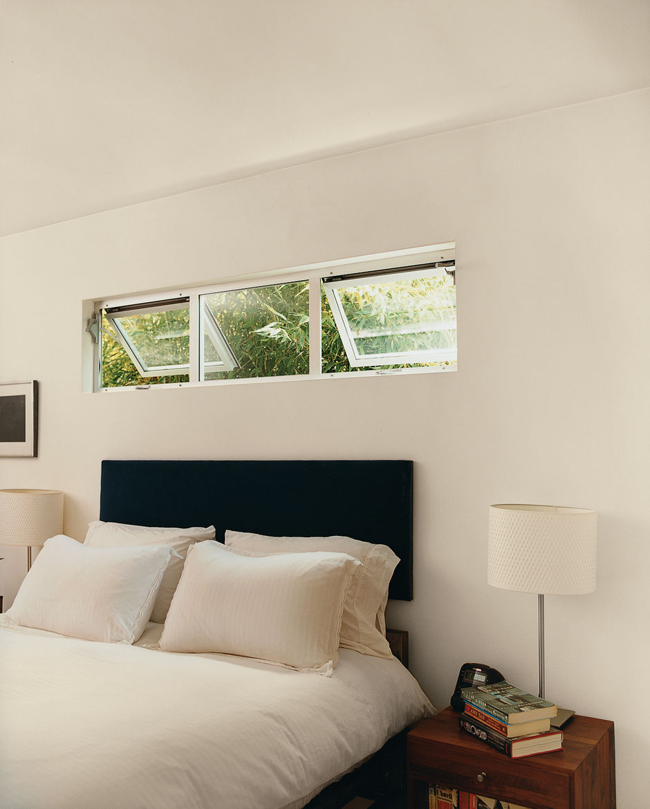 Chunky steel bed frames in the bedrooms were Siegal's first attempt at furnishings.