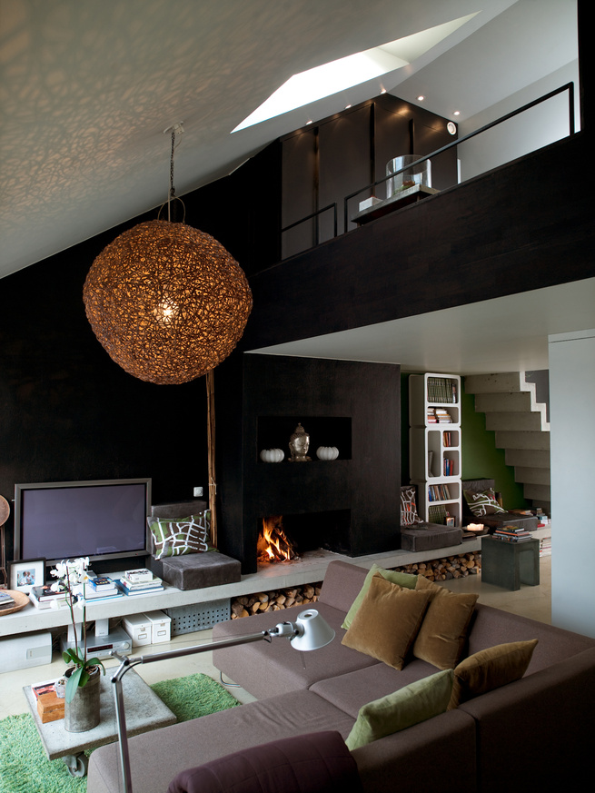"""In the living room, the sofa is built in modules that can be turned to face the terrace in the summertime, or the kitchen in the winter. Photo by <a href=""""http://www.permagnuspersson.com/"""">Per Magnus Persson</a>."""