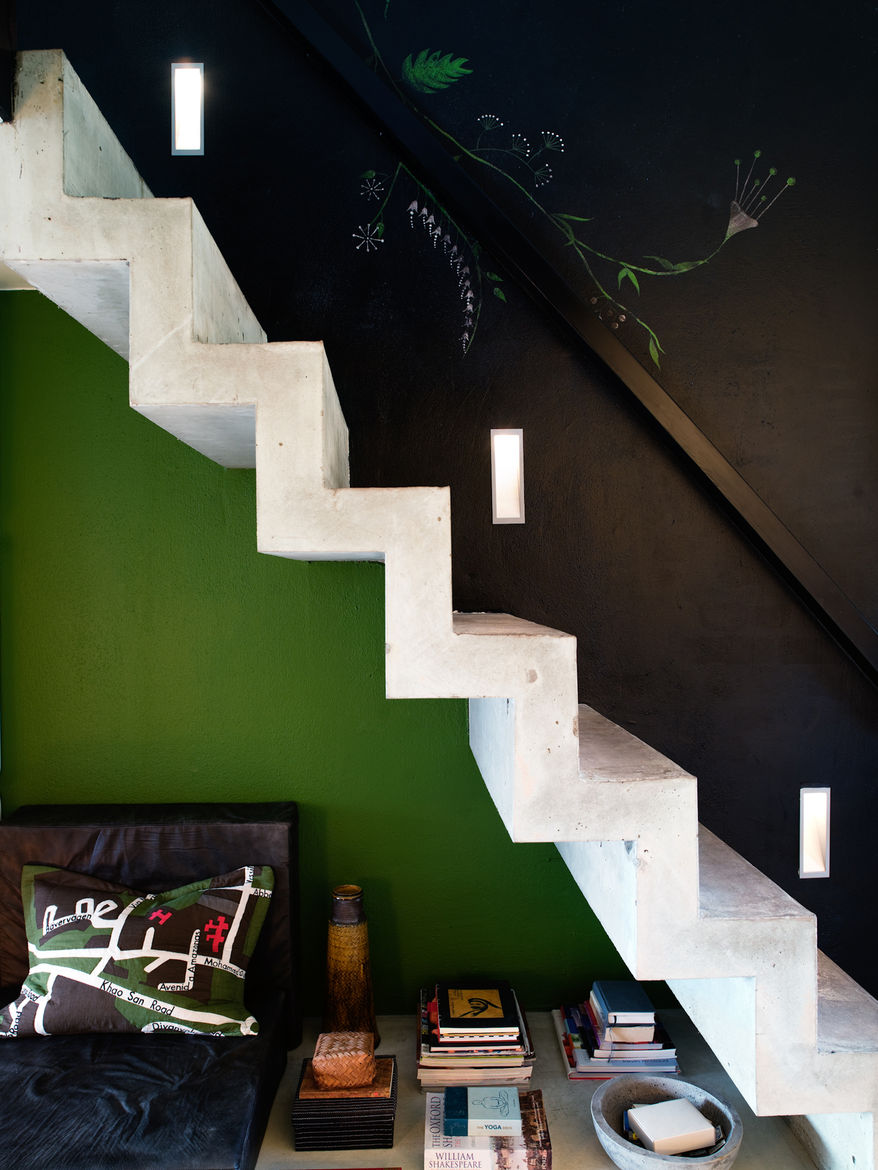 """Concrete stairs lead up to the sleeping loft. Photo by <a href=""""http://www.permagnuspersson.com/"""">Per Magnus Persson</a>."""
