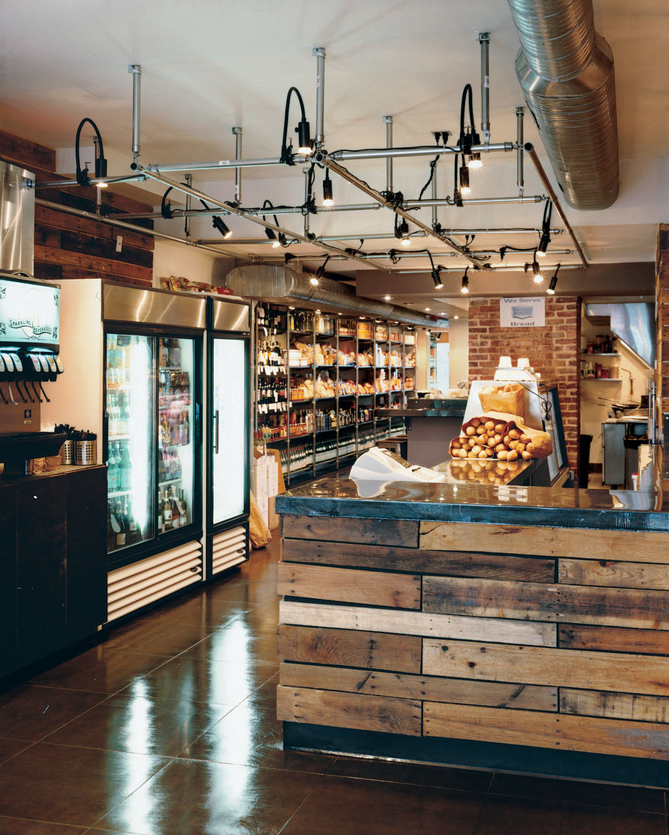 The market's shelves are lined with all manner of Italian goodies, and the lighting grid on the ceiling, made of chain-link fence posts, is a nod to the grids common in Italian delis.
