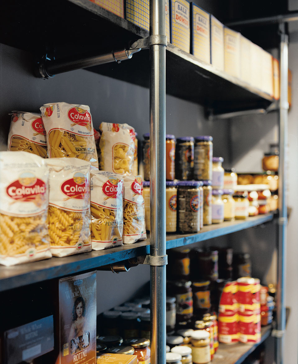 """""""We said to Grupo 7, 'We need you to use the cheapest materials possible, but in a really cool way,'"""" Mazza recounts. Chain-link fence poles hold up the racks of food in the market and support the grid of lights on the ceiling."""