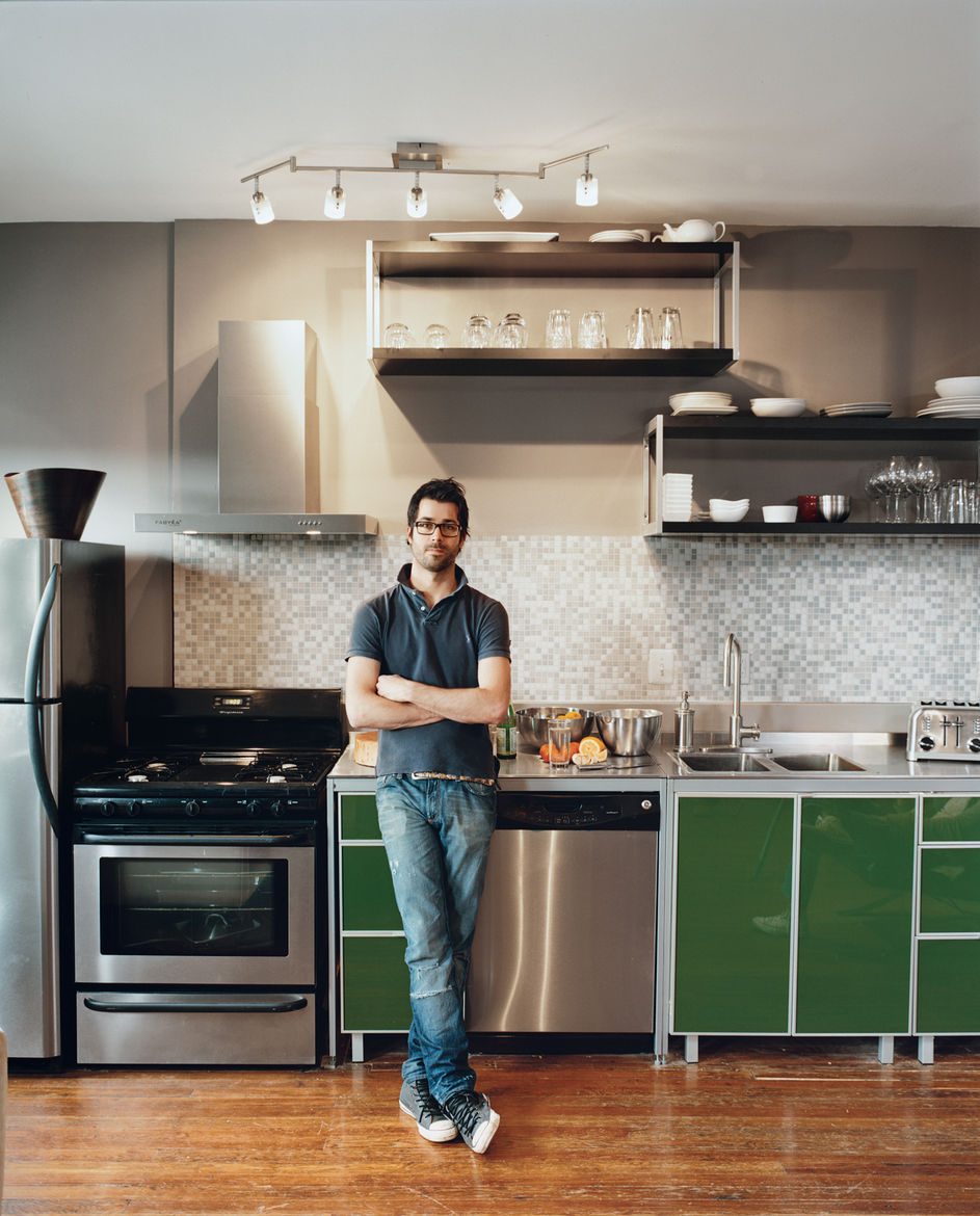 Mazza and Patten both used off-the-shelf Ikea cabinets in their kitchens. They customized them by raising them up a few inches and dropping a sink into a store-bought table, which serves as the countertop. The pair is thrilled with the results. Even the a