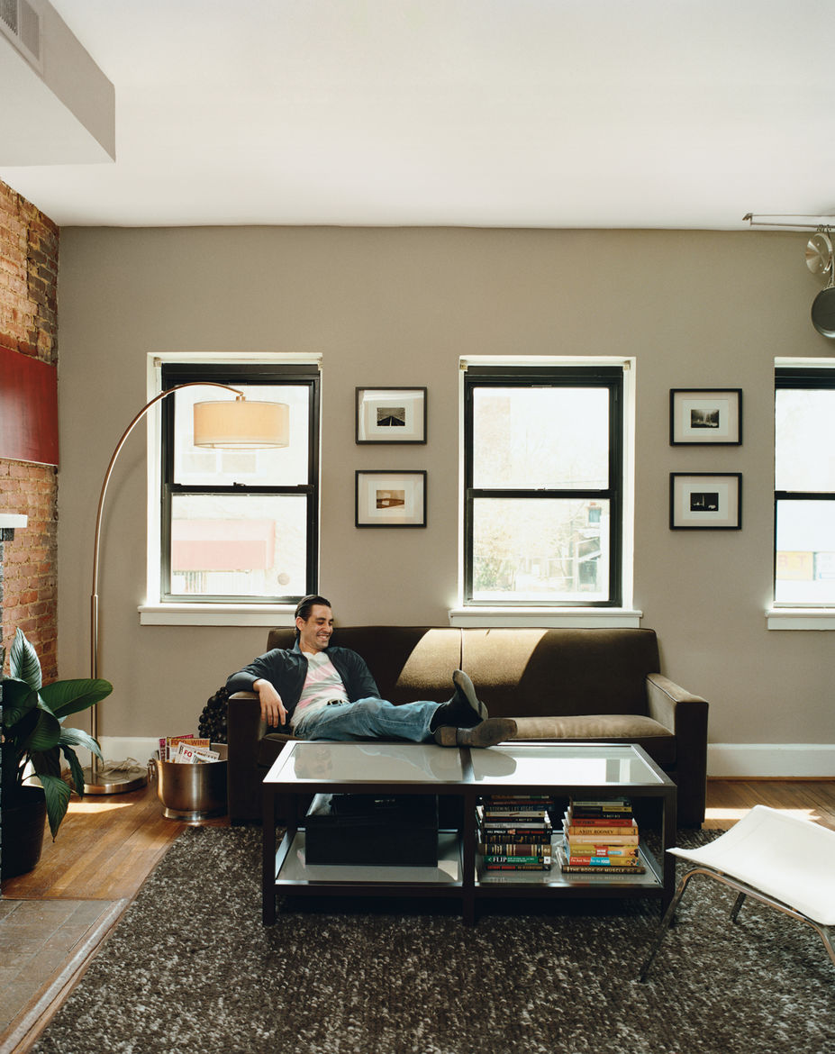 With a perilously limited budget, Mazza and Patten set about making the second and third floors of their new purchase into a pair of 850-square-foot, three-room bachelor pads. Patten's living room on the second floor gets all its light from windows facing