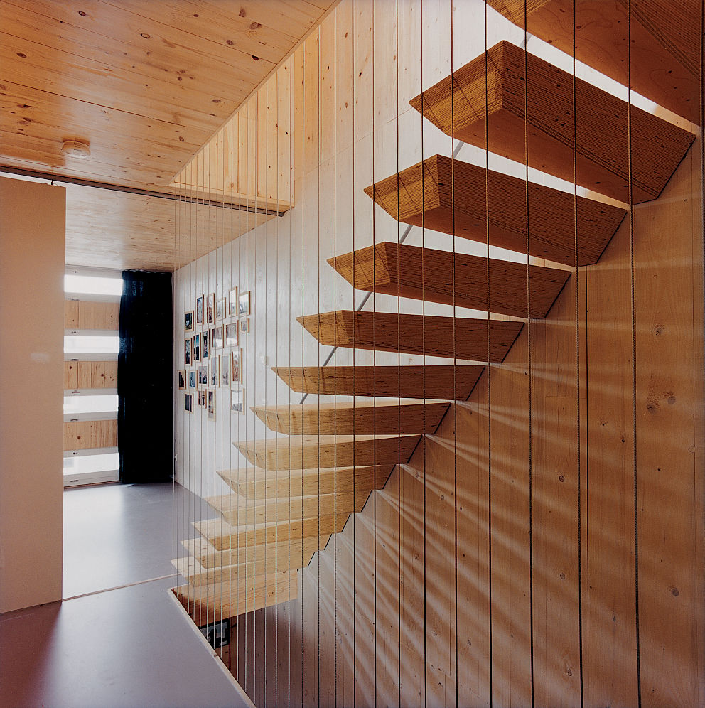 "The ""floating"" staircase is actually supported by steel rods hidden within each step."
