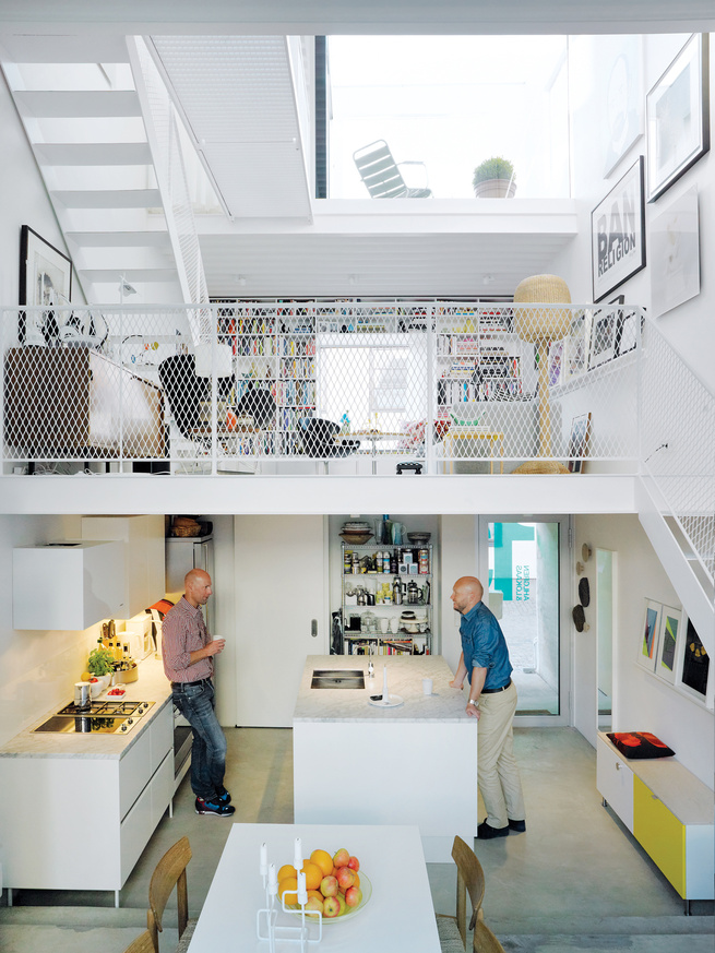 Three thin slabs, staggered vertically through the space, create three distinct floors and allow light to flood in from the front, back, and roof. The white Saari kitchen makes the most of a compact space.