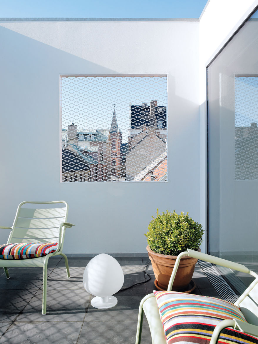 """The roof terrace offers a view of the town square, """"filtered"""" through a grille."""