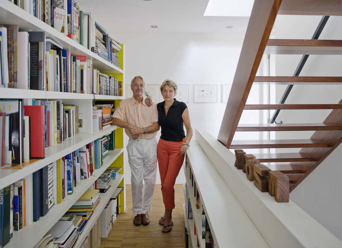 Bob Krone and Paula Van Dijk pose in front of their built-in bookcase. They live in the red unit.