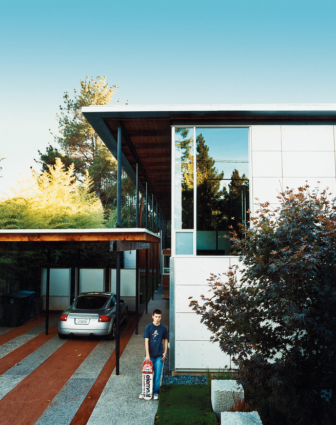 Turning its back to the street and next-door apartment like a curled-up cat, the long, narrow house spills out sideways to the garden, designed by landscape architect Andrea Cochran.