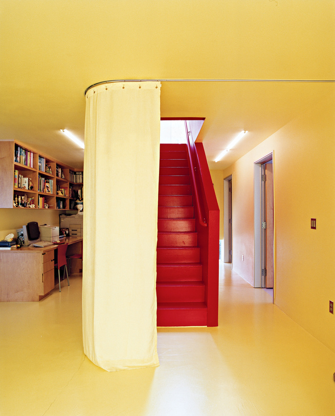 """When residents want privacy (from the outside world or from other family members), sliding curtains, like this one dividing the office from the staircase, create temporary walls between rooms. """"When you close the curtains, you can't see anything,"""" says Wi"""