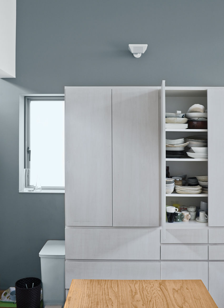 White prefabricated cabinets and countertops make for a streamlined kitchen.