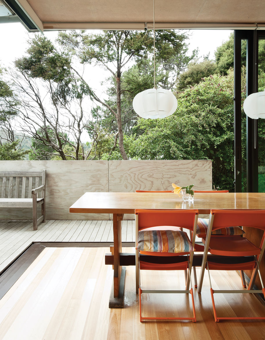 The home's sliding doors blur the boundaries between inside and out.