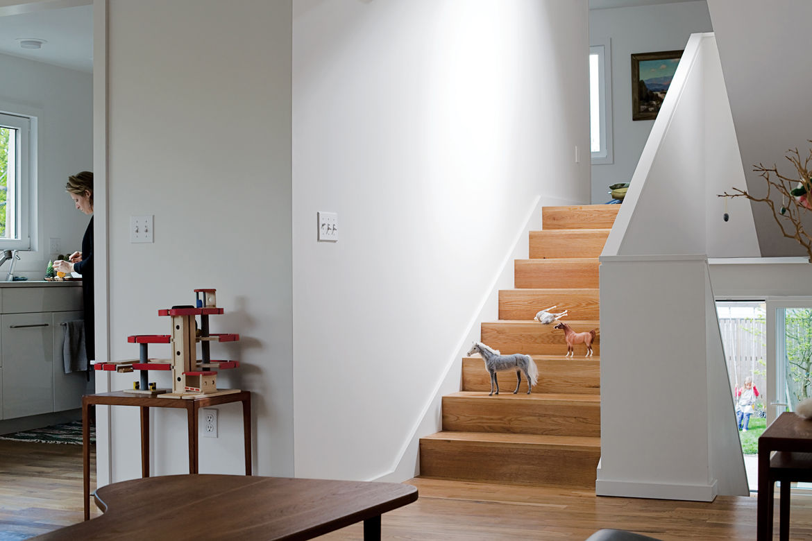 """To maintain the seamless connection from room to room, it was important that the flooring material was the same throughout the house,"" Waechter says. ""We took that continuity down to the smallest detail, eliminating the nosing so the treads look like a f"