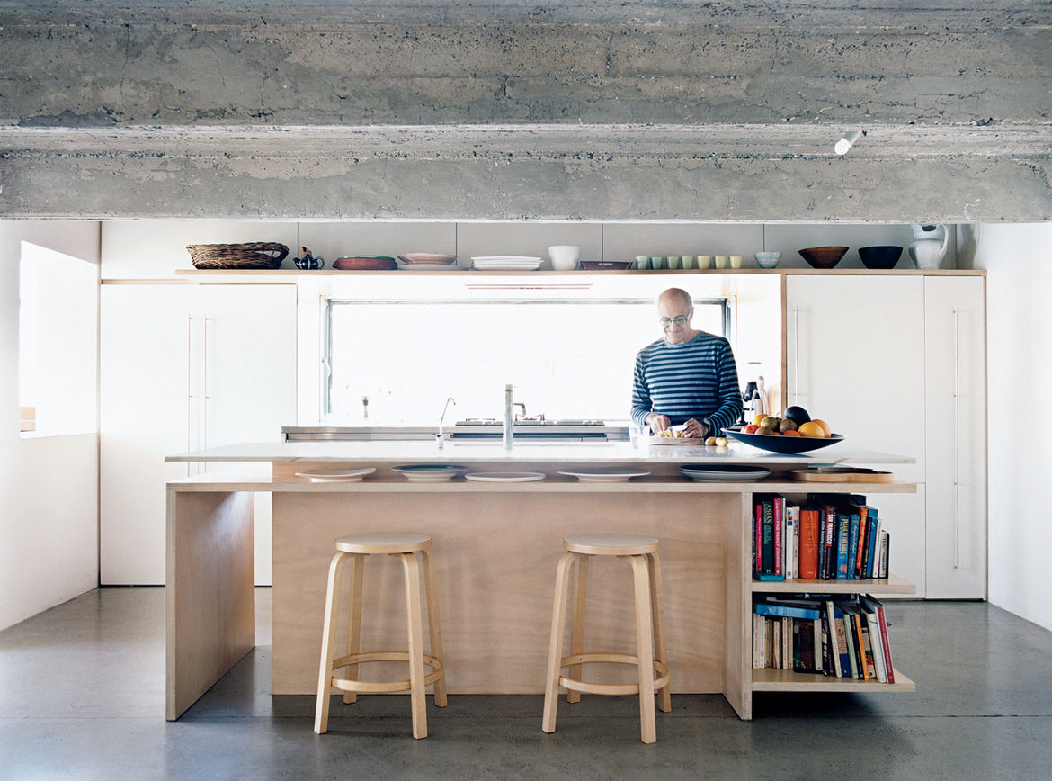 The kitchen includes ceiling lights whose fittings are recessed and offset; their glow is both diffuse and elusive.