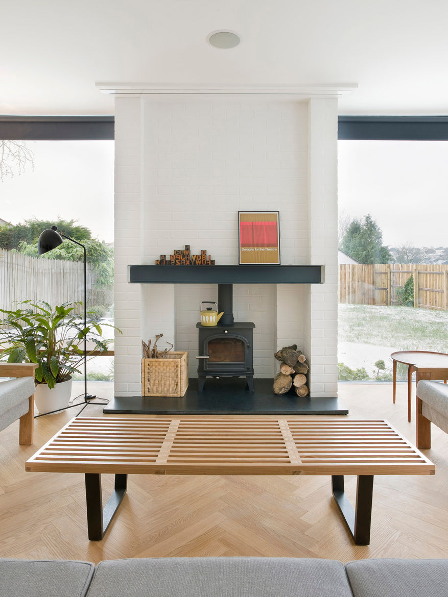 Home interior with small fire stove wood bench