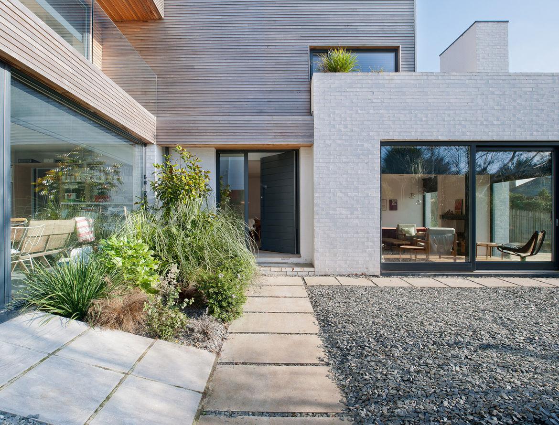 Corkellis house exterior yard shrubs