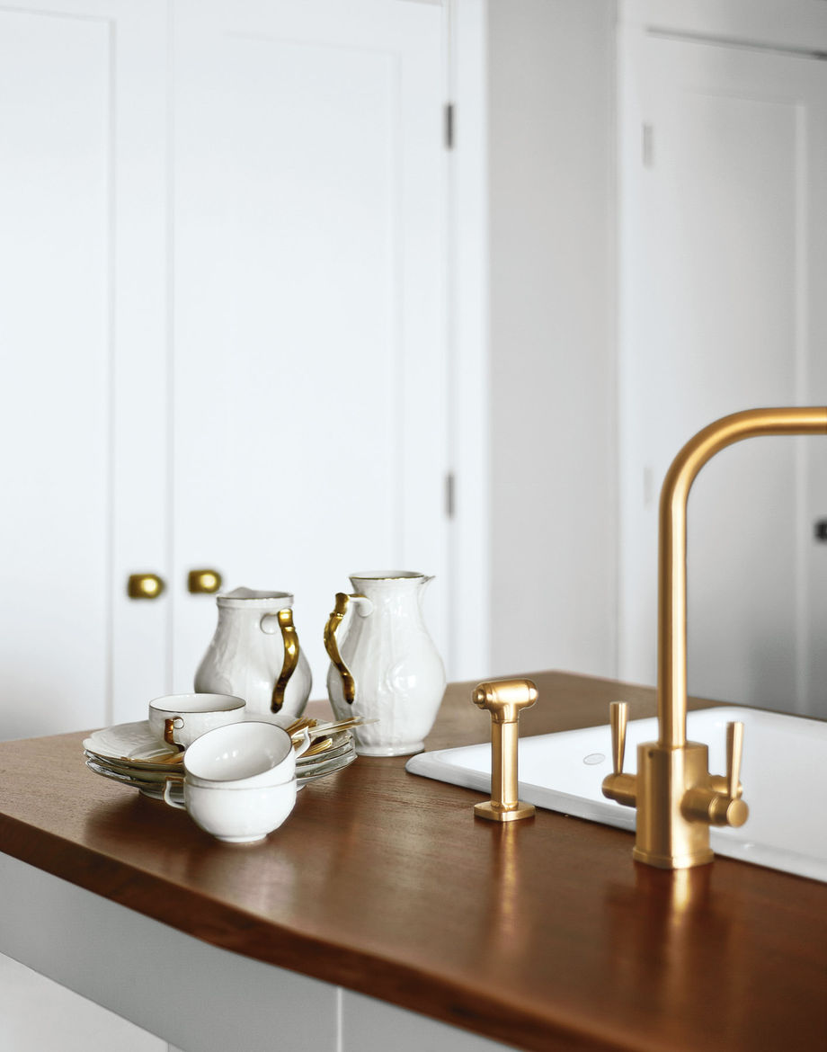 Wood kitchen countertop with Rohl faucet and Rosenthal dishware