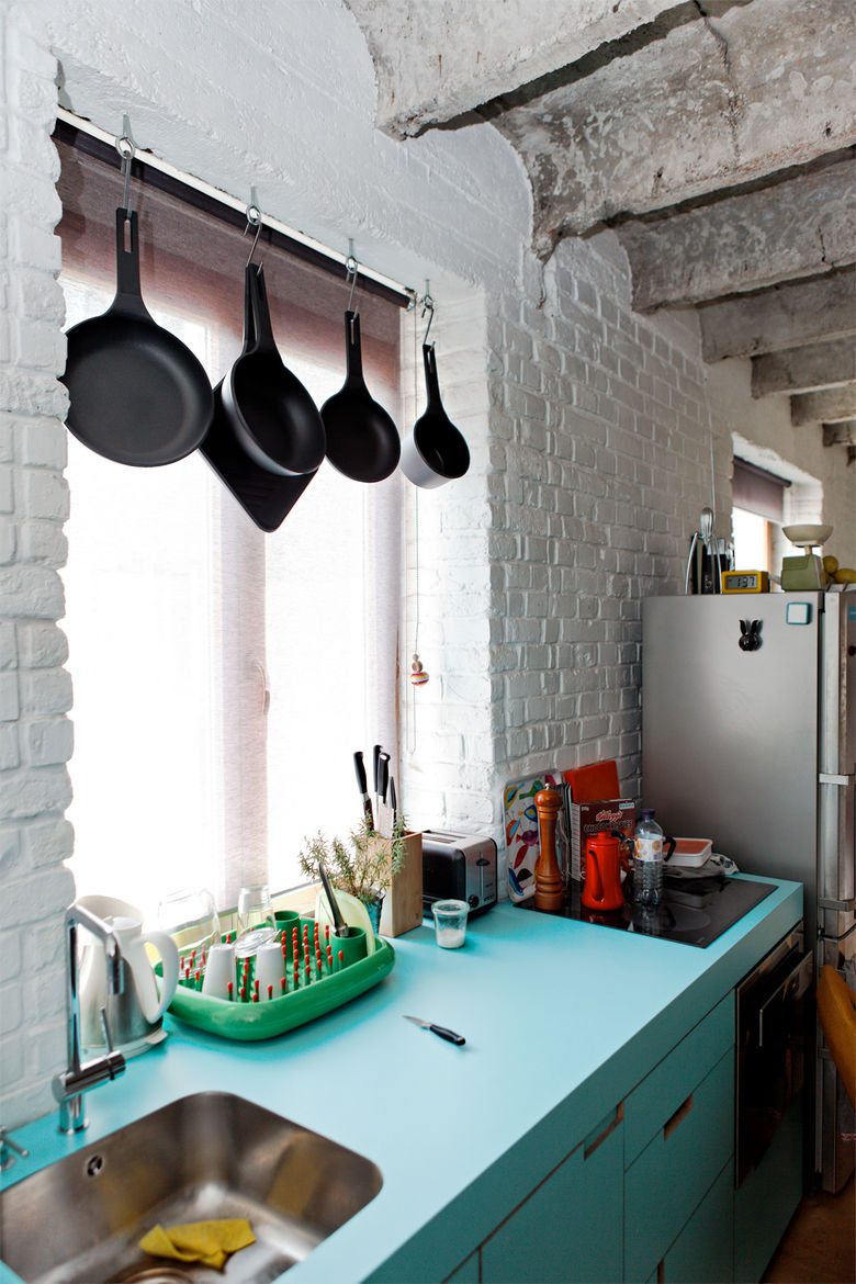 Modern small space kitchen with neon blue cupboards