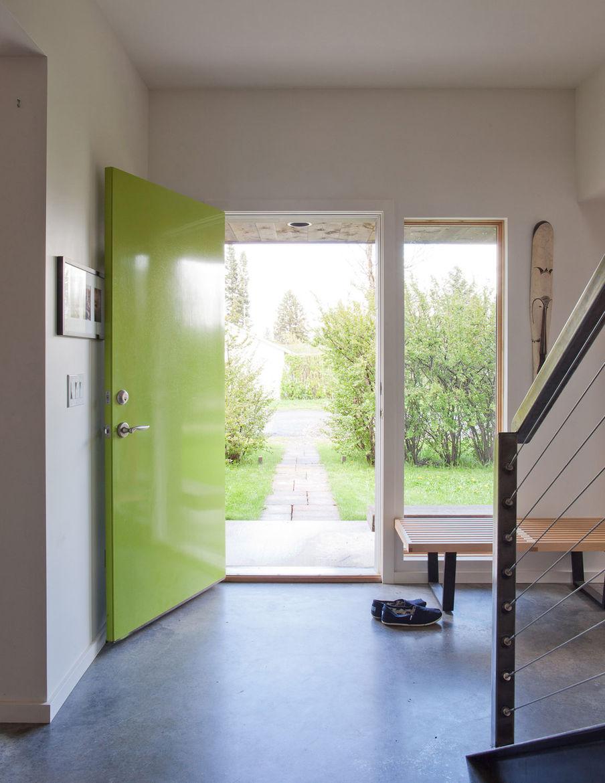 Lime green front door entrance concrete floors