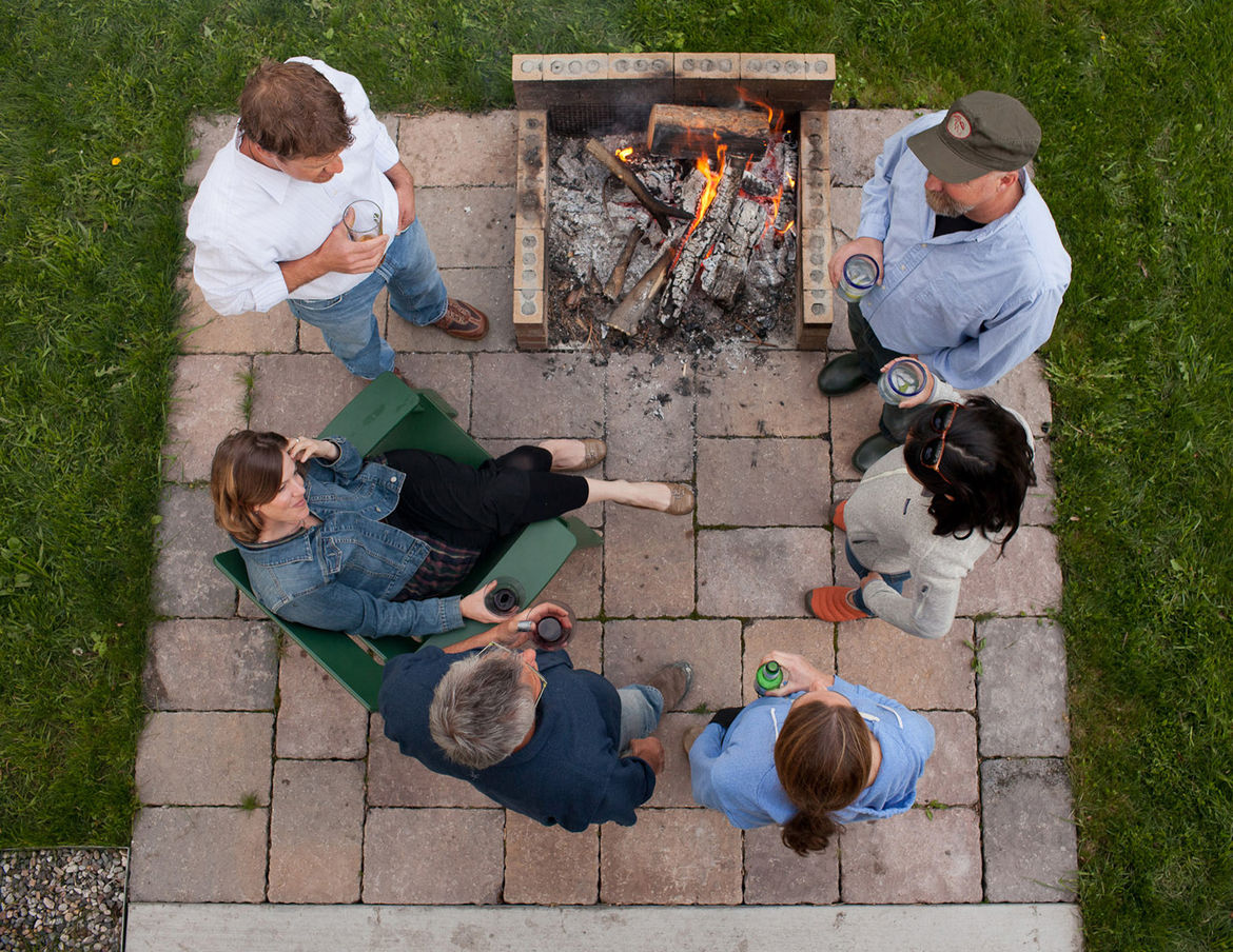 Outdoor brick fire pit social gathering area