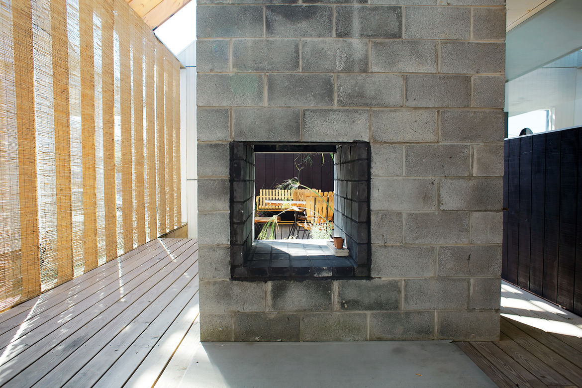 Deck with concrete block fireplace antique wooden furniture