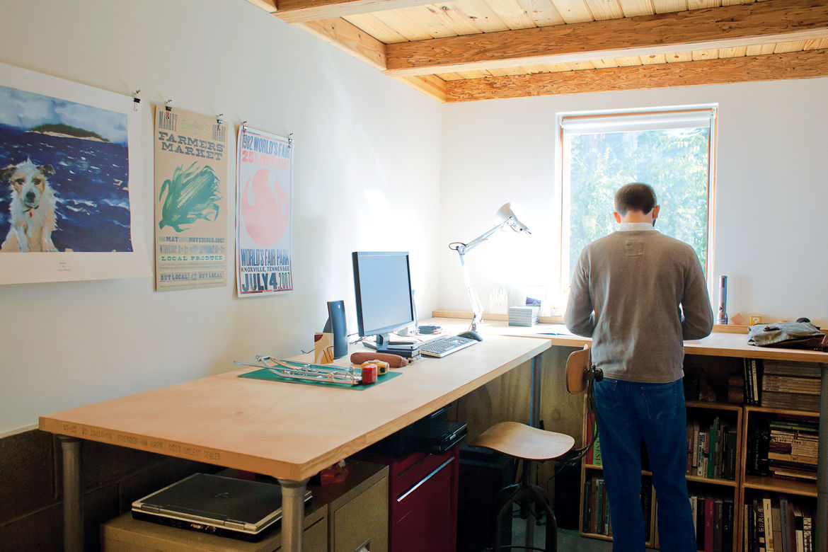 Simple office studio space with plywood ceiling