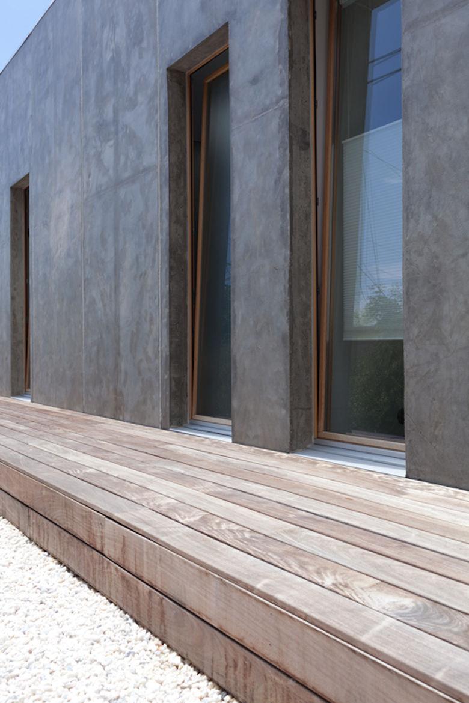 Minimalist concrete panel housing