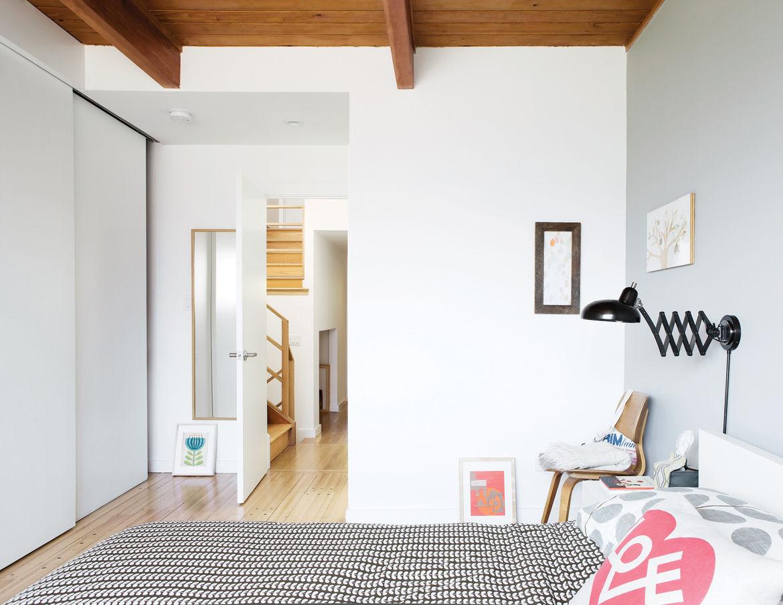Modern bedroom with rolling wooden doors