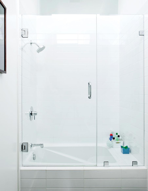 Modern bathroom with tall glass doored soaking tub