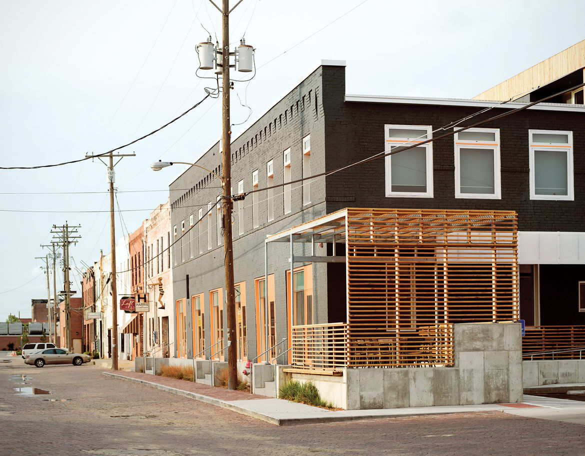 Exterior view of the steel-and-cedar-slat patio on the Finn Lofts