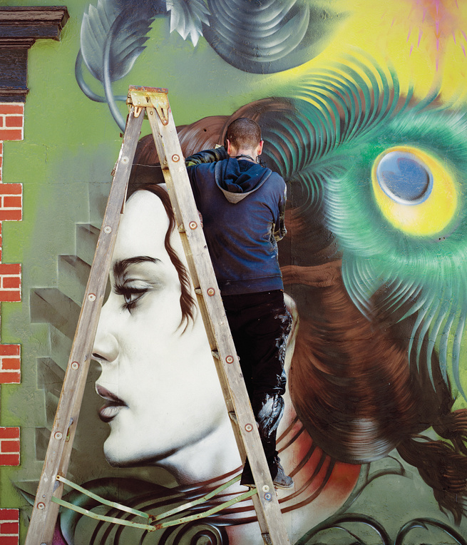 Outdoor wall mural by artist Seth Depiesse on Main Street in downtown Wichita