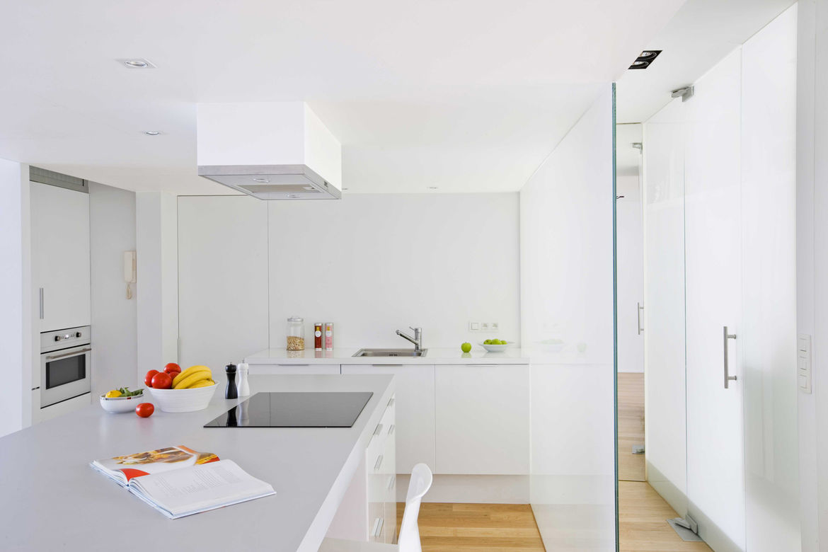 """The kitchen is a mix of custom and off-the-shelf items. """"Because of the budgetary restraints, we planned the kitchen around Ikea's options, with the exception of the big table/work top, which we designed, sourced the laminate for, and then had our contrac"""