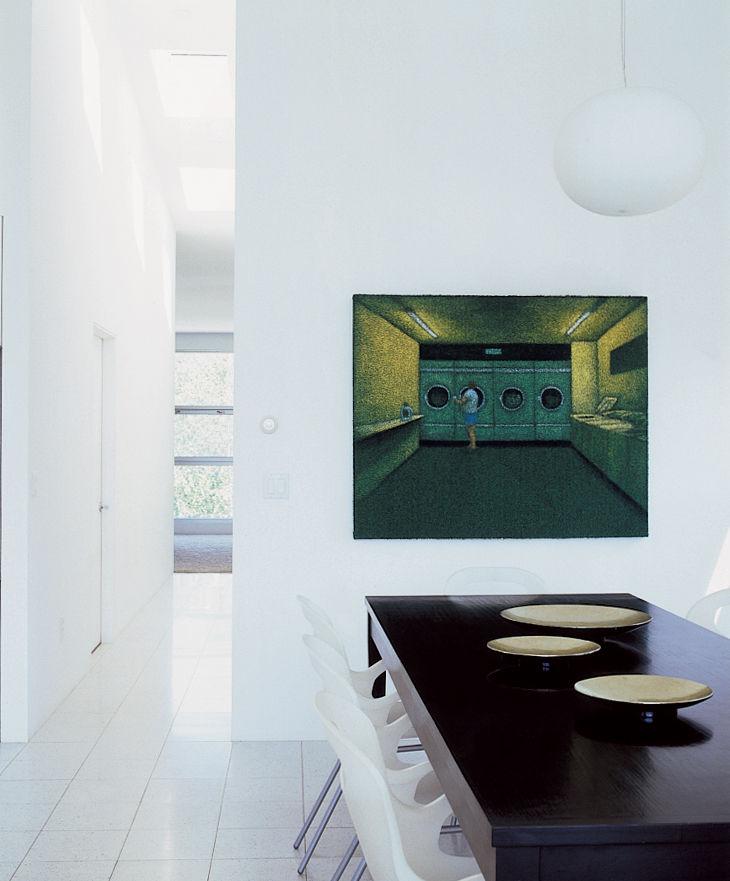 Triem-House dining area with O chairs by Karim Rashid