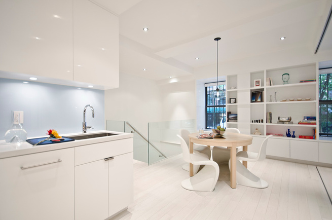 The kitchen was originally long, narrow, and completely closed off from the rest of the apartment. Miller opened up the plan to create a more spacious feel.