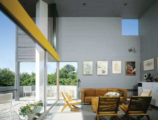Modern open-plan living room with gray walls