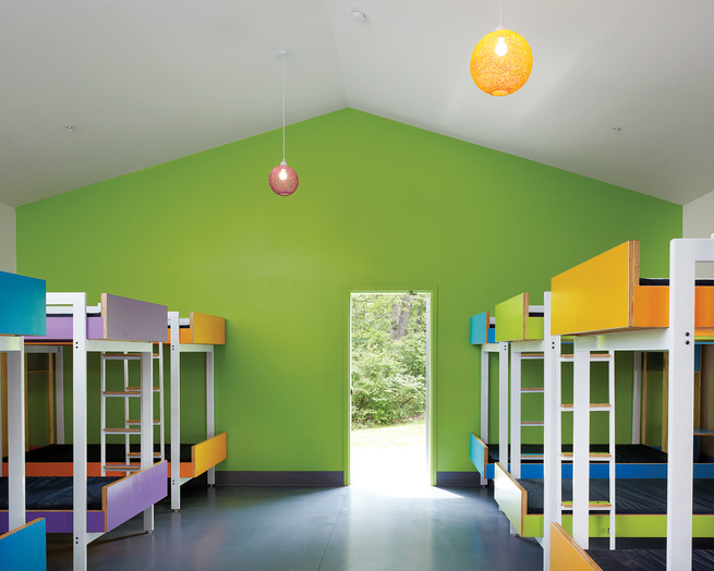Modern cabin interior with colorful bunkbeds