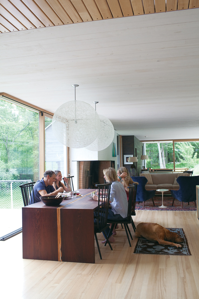 Modern dining room with vintage chairs and custom-designed wenge-wood table