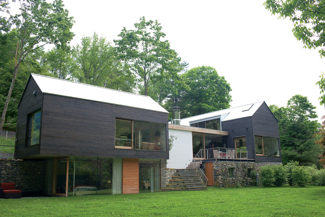 Modern vacation home with gable-roofed structure