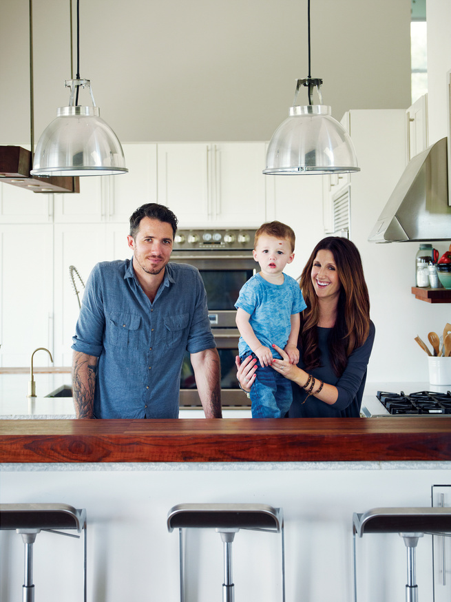 Modern family in their kitchen with Titan 1 Pendant lights