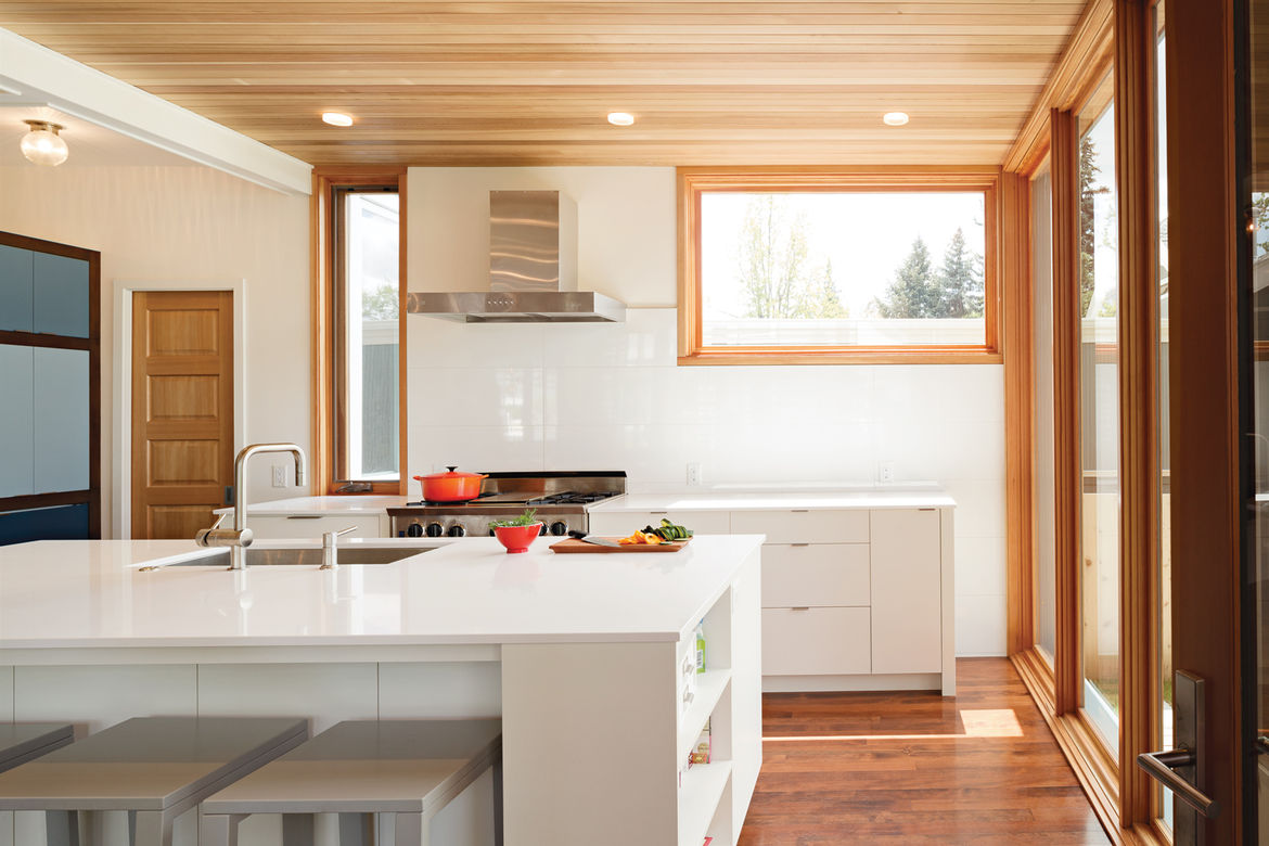 Modern kitchen with Silestone countertops and custom cabinetry