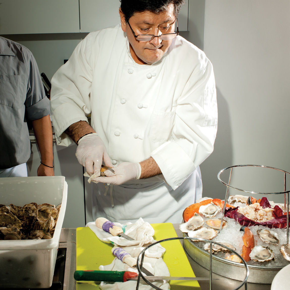 Chef shuckling oysters