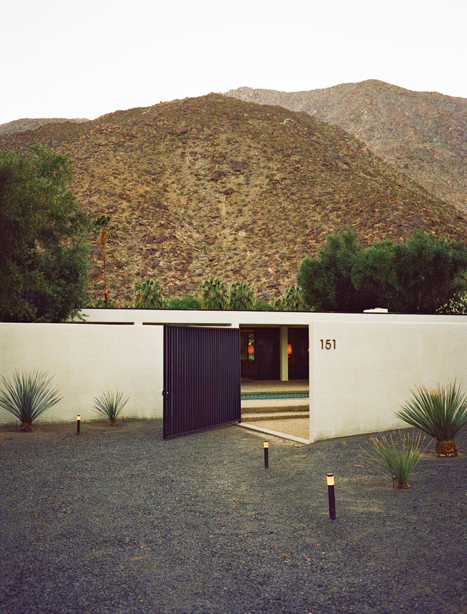 Modern hillside weekend box home with gated entrance