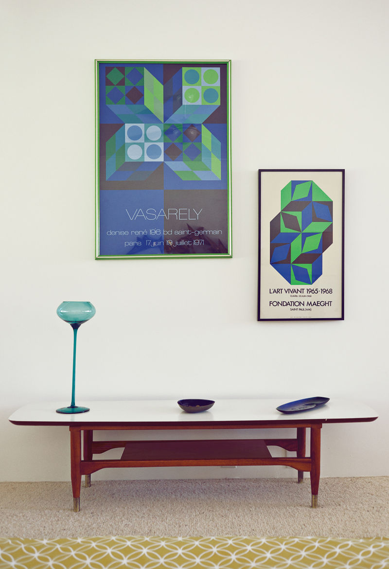 Side wall area with posters by Victor Vasarely and wooden desk