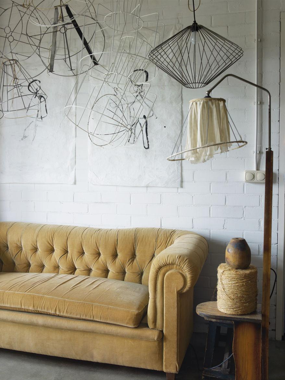 Felt studio space with antique yellow sofa