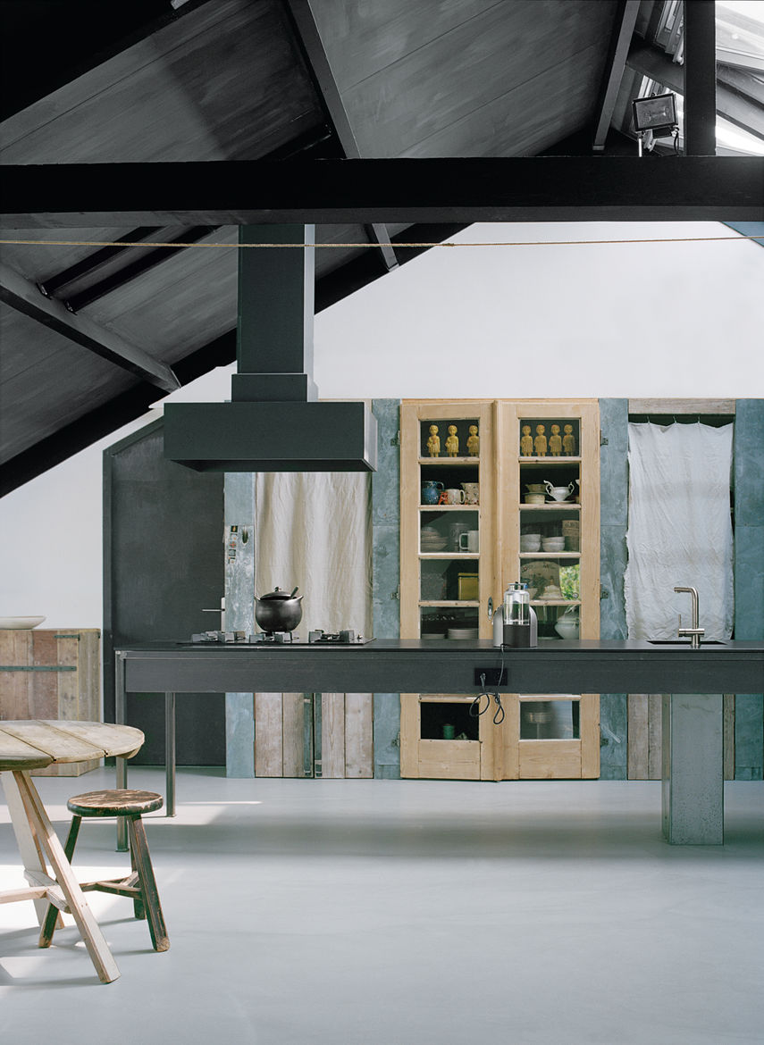Modern kitchen with zinc pantry and salvaged wood flooring